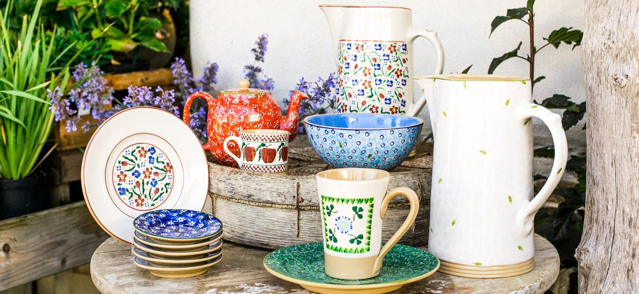 Collection of colourful pottery by Nicholas Mosse at Duchy Nursery.