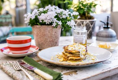 Stack of pancakes with Cornish honey and a large cup of coffee.