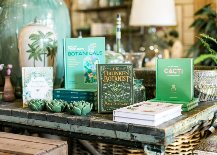 A selection of books about gardening and lifestyle on a table in the Duchy of Cornwall shop.