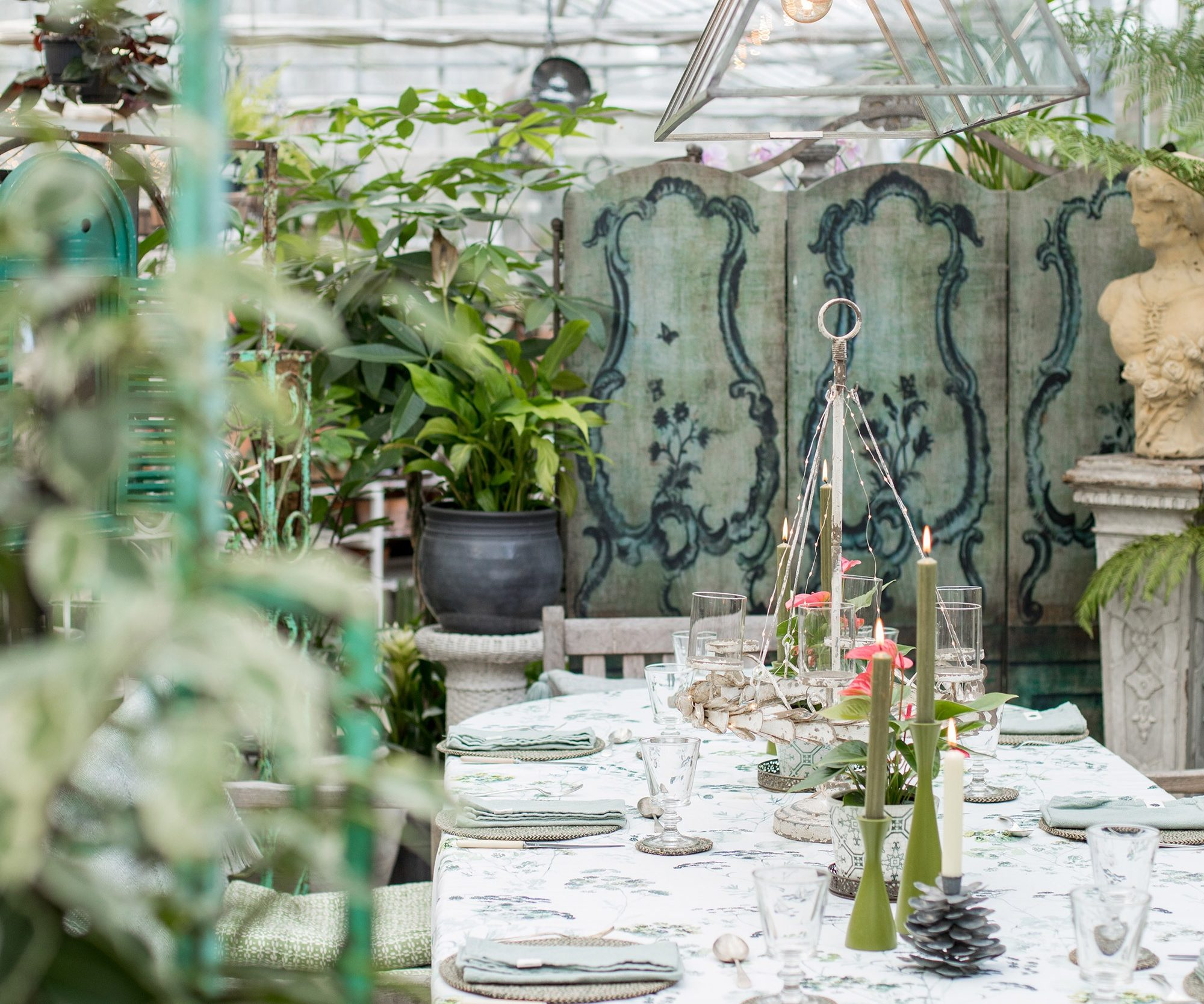 The Garden Room, a private venue at the Duchy Nursery with a dining table and a blue wooden screen.